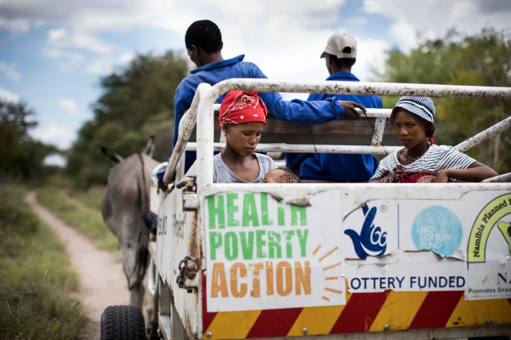Xao (left) uses a donkey cart ambulance to reach the health centre. Donkey cart ambulances are often the only transportation that can navigate through the difficult terrain in Tsumkwe.