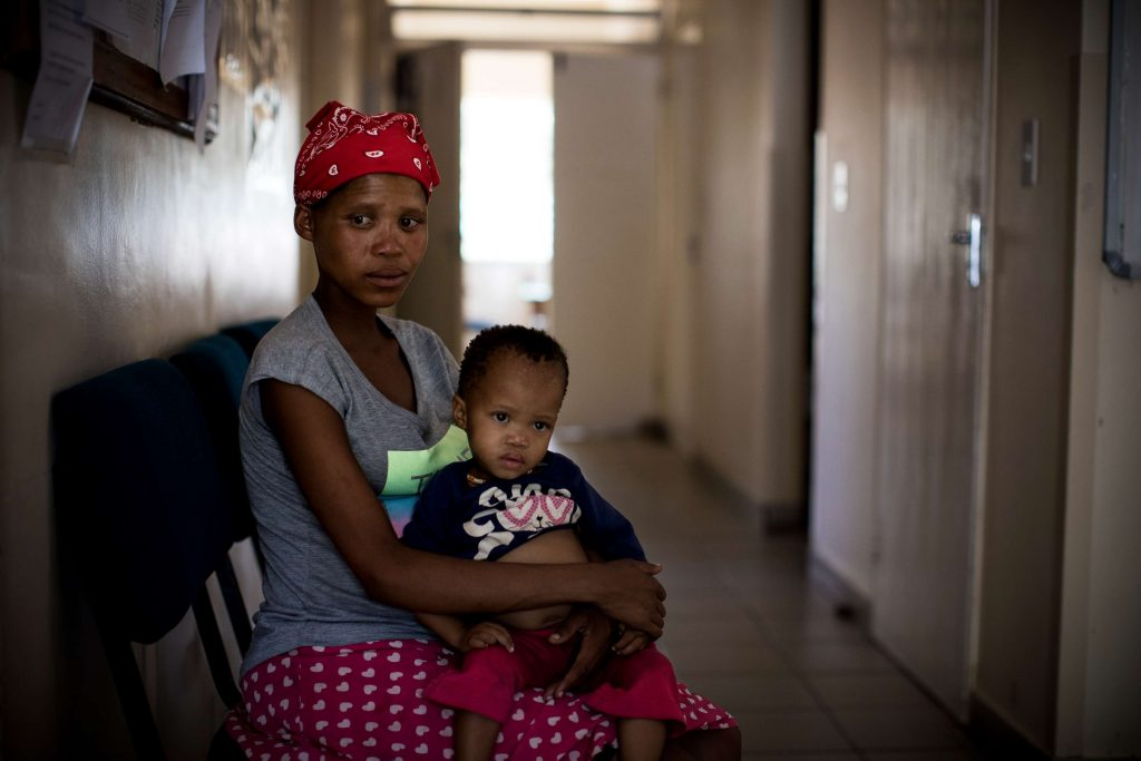 An indigenous San mother waits for her check up at a health centre in a rural Tsumkwe, Namibia.